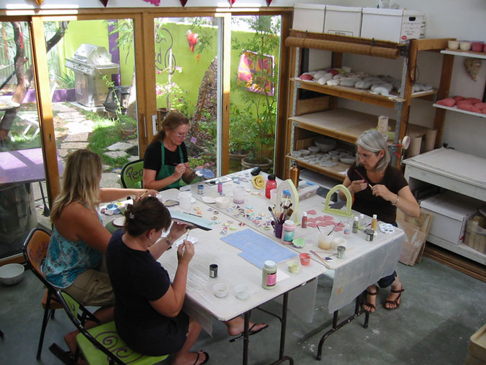 Four Participants Glazing in the Studio